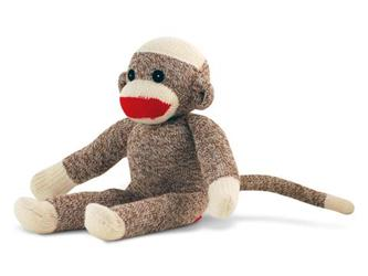 sock monkey sitting